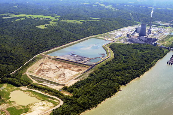 LG&E's Trimble power plant dominates the region with its giant stacks and resulting pollution. In this picture the existing  coal ash ponds are in the foreground. Now, it is hard to say just where all the ash will go for the power plant. Photo © John Blair